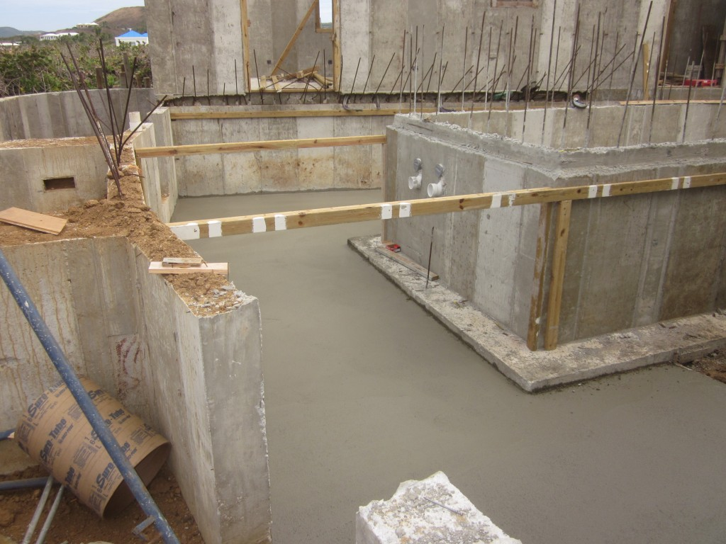 3-25-2011 - Concrete floor for small storage area around pool