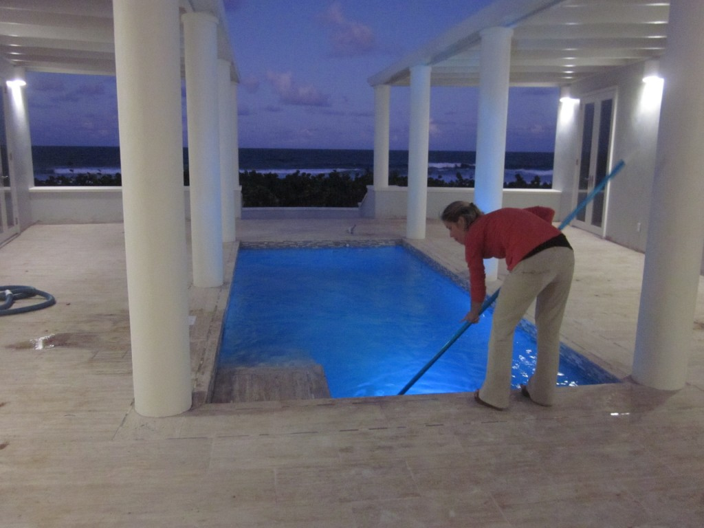 1/20/2012 - Emily cleaning the newly finished pool